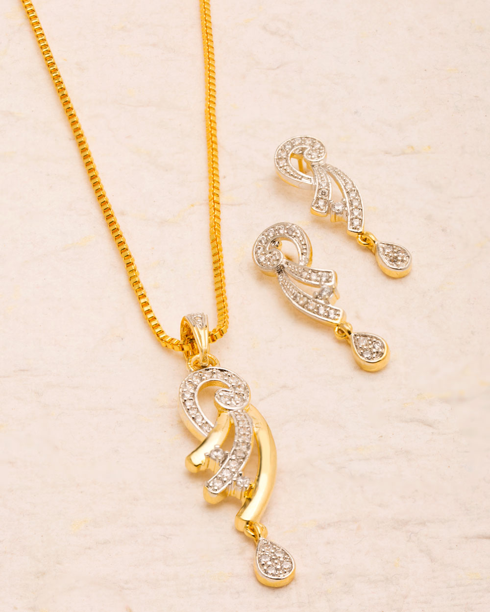 Buy pretty gold plated sparkling cz pendant set online india voylla charming gold plated pendant set in sparkling cz mozeypictures Images